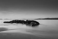 Glassillaun Beach (John Holmes (DAJH51)) Tags: connemarra glassilaun beach blackandwhite hills ireland longexposure monochrome mountains rocks sand sea seaweed sunset