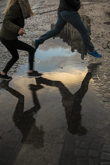 #19 (hans snoek) Tags: amsterdam jump puddle reflection girls pavement streetphotography hanssnoek