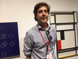 Sammer Gallery owner Ignacio Pedronzo in his booth Modern Art at Pinta