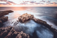 sundown at gozo (ikonoblast) Tags: sundown gozo malta sunset light ocean sea seascape travel blur longexposure fuji fujixe2 fujinonxf1024 blue cloud clouds rock stone cliff cliffs