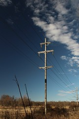 Power lines on the edge of town (cdw9) Tags: img44767jpg autoupload pole powerlines polarizer arkansas country sky