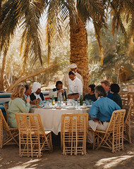 AAHV001233 (   ) Tags: africa travel people male men tourism sahara female table outdoors chair women adult furniture seat group egypt middleeast lifestyle resort meal service recreation humanrelationships seatingfurniture groupofpeople enjoyment diningtable ecotourism northernafrica diningchair caucasianethnicity siwaoasis libyandesert matruhgovernorate adrreamellal