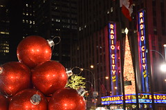 Red at Radio City (afagen) Tags: christmas nyc newyorkcity red sculpture newyork night marquee manhattan rockefellercenter ornament radiocitymusichall radiocity exxonbuilding 1251avenueoftheamericas
