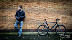 321:365:2013 - Me and my ride. (phil wood photo) Tags: november orange selfportrait black me wall bricks mountainbike o2 365 day321 project365 2013 sprayway colourchallenge 3652013 17112013