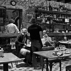 men in a restaurant (x1klima) Tags: voyage street leica travel friends light blackandwhite bw man france men art caf monochrome beauty laughing 35mm wonderful square fun mono restaurant licht cafe friend couple mood friendship noiretblanc lumire candid models culture streetphotography talk vine guys menschen human luck friendly traveling monochrom lovely capture talking temptation freundschaft hearing hollyday reise x1 wein voyages nonnude glck elmarit schwarzweis bauxdeprovence leicax1 x1klima labistrotduparadou