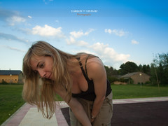 Young blonde woman leaning forward at the playground (Carlos Ciudad - Stock Photography) Tags: portrait sky espaa woman hot grass playground clouds hair mujer spain europa europe affection retrato young longhair mother olympus sensual leon cielo nubes blonde rubia care escote madre pelo gettyimages joven calor hierba cario cleveage ropainformal parqueinfantil casualclothes castillayleon inclinada agachada comprension e520 leaningforwards castilleandleon neackline cctrillastock villarrodrigodelasregueras understantdng