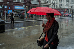 . (Le Cercle Rouge) Tags: greatbritain red people woman reflection london rain umbrella unitedkingdom human walker oxfordcircus wwwlecerclerougecom