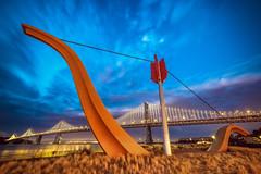 San Francisco Embarcadero (Mike Filippoff) Tags: sanfrancisco night bay colorful cloudy ngc baybridge embarcadero