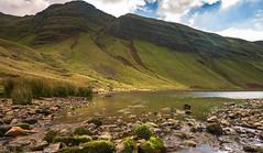 Llyn Y Fan Fach - View 1 (absynth100) Tags: wales landscape water mountain rocks fall autumn calm serene peak reflections cliff uk breconbeacons stones grass sky clouds