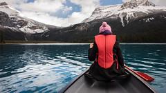 Julie canoeing on Lake louise (Chris Shanks) Tags: canon canada chris shanks sunrise autumn alberta banff landscape lake louise water clouds mountains rockies