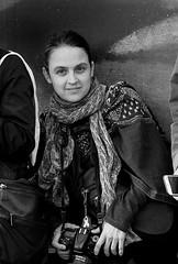 Street portrait, Trafalgar Square, London (chrisjohnbeckett) Tags: street portrait smile bw blackandwhite monochrome london londonist timeout people trafalgarsquare urban photographer camera canonef135mmf2lusm chrisbeckett working woman nikon