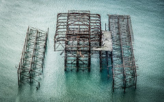 The Skeleton of Brighton Pier (DobingDesign) Tags: brighton pier sea ocean water burnt structure abandoned decaying fallingapart seaside sad skeleton architecture lines geometric obliqueview metal ironwork warped old burned scorched rusty remains fragments