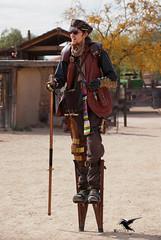 Steampunk - Walking Tall on Main Street (thePhotographerRaVen) Tags: steampunk tucson oldtucson arizona wwwc wwwc5 wildwest fantasy leather stilits photosbyraven