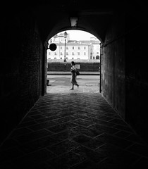 (Koupal D) Tags: italia italy alleyway vicolo woman light blackandwhite bw monochrome cobblestone ciottolo nikond610 tokina1628mmf28 pisa buildings lamppost road walls