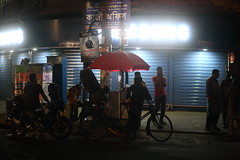 Kazir Dewri Mood (N A Y E E M) Tags: rickshaw motorbike people men lastnight latenight light atmosphere colors red mood street kazirdewri roundabout chittagong bangladesh sooc raw unedited untouched availablelight bokeh samsung store