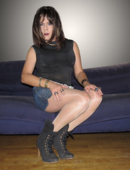 Sitting pretty! (Irene Nyman) Tags: irene nyman dutch tgirl transgender holland blue denim skirt high heeled bootsies sitting prietty couch bench brunette stare eyes mini nude pantyhose