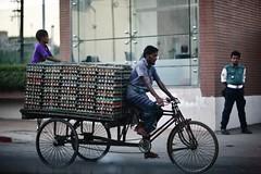 The Eggs Are Hatching (N A Y E E M) Tags: rickshawvan eggs boy men policeman traffic candid dusk street gmroad chittagong bangladesh windshield