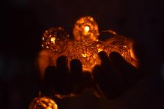 Captured light (hannacsilla) Tags: light lamp wire christmas bright dark hands