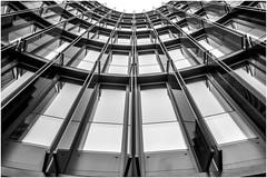 Oval Office II (tosch_fotografie) Tags: oval office bro brogebude architektur symetrie fenster glas spiegelung klappen gitter himmel senkrecht schwarzweis schwarz weiss abstarkt metall bogen rund linie kln nrw deutschland olympus omd em1 12mm