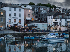 Harbour lights, Falmouth (Caroline Oades) Tags: falmouth harbour lights twinkling dusk twilight boats reflections wetreflections water sea ocean buildings houses pub dinghy 2662016 178366 cornwall yachtrace physis sailadayok