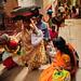 The people caravan navigates the narrow alleys of Varanasi.