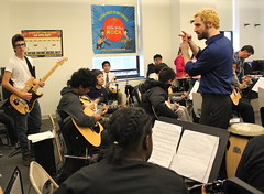 Little Kids Rock Teacher Jude Traxler calls motions an E Chord during a blues jam with Liberty DeVitto on the drums (littlekidsrock) Tags: acoustic