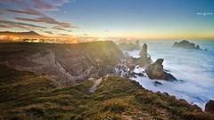 Lights and cliffs. ( Mario Gutirrez Photographer) Tags: ocean blue light sunset sea cliff night spain europe bluehour