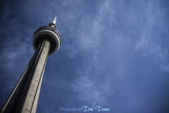 CN Tower (bak3rme) Tags: city blue sky urban toronto canada building architecture clouds cn canon big colorful downtown chinatown cityscape cntower citylife streetphotography tall dowtown towering downtowntoronto torontochinatown streephotography canoneos50d