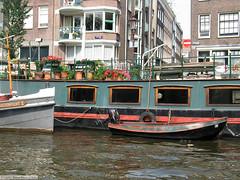 Houseboat (gerry.bates) Tags: street city houses urban holland netherlands dutch amsterdam architecture canon boats design canal european planters traditional houseboat noordholland gracht flowerpots capitalcity woonboot oudeschans