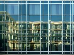 Savona con Meg (fotomie2009) Tags: reflection riflesso savona complesso bofill porto liguria italy italia riviera ponente ligure distorsione pattern vetrate specchi deformanti multipli