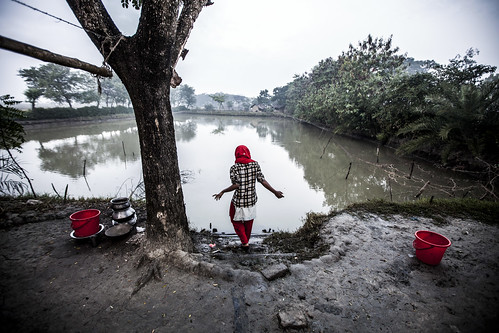 Meghla washes up early morning in Khulna, Bangladesh. Photo by Felix Clay/Duckrabbit.