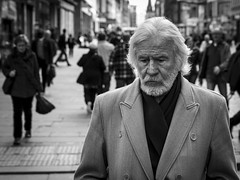 A Depth Of Sorrow (Leanne Boulton) Tags: people monochrome urban street candid portrait portraiture streetphotography candidstreetphotography candidportrait streetlife elderly old man male face facial expression look emotion feeling atmosphere sadness sad misery unhappy weight sorrow separation backlit beard tone texture detail depthoffield bokeh natural outdoor light shade shadow city scene human life living humanity society culture canon 7d 50mm black white blackwhite bw mono blackandwhite glasgow character scotland uk