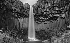 a composition of nature in B flat minor (lunaryuna) Tags: iceland southiceland skaftafellmountainrange skaftafellnationalpark svartifoss waterfall columnarbasalt rockface rockformation le longexposure rivergorge nature landscape beauty lunaryuna blackwhite bw monochrome