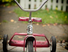 the Roadmaster (annapolis_rose) Tags: vancouver neighbourhood redtricycle tricycle trike kidsbike outdoors