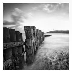 Standing Guard (yadrad) Tags: porlock porlockweir somerset harbour groyne fujixt2 seadefence blackandwhite longexposure