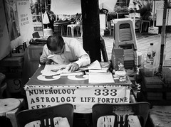 Fortune teller - he can read your future but unfortunately he needs magnifying glass to read newspaper  (-Faisal Aljunied-) Tags: faisalaljunied ricohgr streetphotography fortuneteller singapore numerology astrology fengshui streetlife