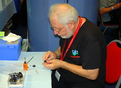 Bertrand Deleest working on an 'Eggplane', Maquettexpo 2016. (Roly-sisaphus) Tags: modelshows maquettexpo2016 hyeres southoffrance scalemodels nikond802016dsc1239 bigbear
