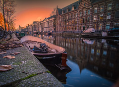 Amstergdam sunset (Dmitry_Pimenov) Tags: amsterdam canal city cityscape citta architecture urban awesome beautiful bello sky sunset sun water reflection boat building evening europe europa dipimenov dmitrypimenov travel trip    holland netherlands netherland fujifilmxt1 samyang12mm