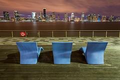Jersey City (Amar Raavi) Tags: jerseycity cityscape skyscraper outdoor pier pier25 newyorkcity nyc newyork buildings hudsonriver waterfront riverfront city urban chairs relax view dusk cloudy unitedstates newjersey manhattan downtown nightscape citylights
