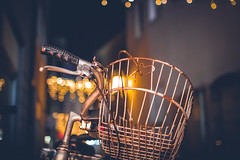 Bokeh Basket (thethomsn) Tags: bokeh basket bike bicycle fahrrad lenker handlebar curved night dark availablelight city street rusty creamycolor christmasseason sigma30mm14 thethomsn