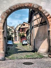 103 Colmar France (saxonfenken) Tags: 6800city 6800 colmar france alsace arch cobbles street yourock gamewinner challengeyouwinner