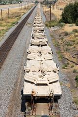 Tanks On A Train (Duncan Rawlinson - Duncan.co - @thelastminute) Tags: 1m7btkss5jq7n8hzbf4dcjv8g5wytuazjw 5dsr canon canoneos5dsr duncanrawlinsonphoto duncanrawlinsonphotography duncanco munitionstrain photobyduncanrawlinson roadtrip roadtrip2016 roadtriptoburningman2016 shotwithcanoneos5dsr technology vehicle aggression armedforces armored armour arms army attack battle combat conflict defense fight force forces front gun heavy httpduncanco httpduncancotanksonatrain military power rail railway security tank tanks tanksonatrain tanksontrain train traincargo traincarryingtanks traintracks transportation violence war warmachine wars weapon weapons