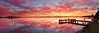 The Sky Exploded (Torkn2U) Tags: sunset panorama lake colour water dusk belmont pano jetty smooth dramatic peaceful calm wharf colourful lakemacquarie squidsink