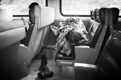 sleeping girl (omoo) Tags: bw feet girl socks train toes nap boots sleep comfort traintravel metronorth trainwindow blackboots passengercar trainseats bwphotograph sleepinggirl trainpassengers bootsoff dscn8855 girlwithmobilephone sleepingonatrain passengersonatrain betweenstations onthewaytopoughkeepsie