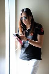 Jo (Don Abrenica) Tags: woman window sunglasses nikon availablelight naturallight jo nikkor 70200 rayban texting vrii d700
