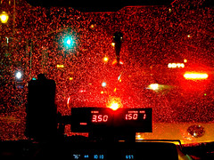 red tide. (jdx.) Tags: nyc newyorkcity nightphotography light red eastvillage newyork abstract trafficlights color cars car rain night lights traffic manhattan taxi iphone jdx iphoneography sonyqx10