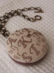 bag_charm001 (amujpn) Tags: crossstitch letter alphabet initial talisman bagcharm chocolatebrown handembroidery