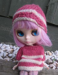 Mel wearing a knitted hat and sweater