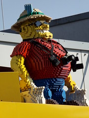 pixelated photographer (Notquiteahuman1) Tags: lego dslr dslm compactcamera construction statue yellow glasses legoresort gnzburg germany tropicalhelmet expedition human entrance amusementpark fun