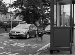 Sitting Down On The Job (cocabeenslinky) Tags: sitting down on the job september 2016 blackwhite black white bw blackandwhite cyclist bicycle road bus stop cycling man car vw eastend east end london city capital photos photography panasonic lumix dmcg6 g vario cocabeenslinky england united kingdom uk laidback bike
